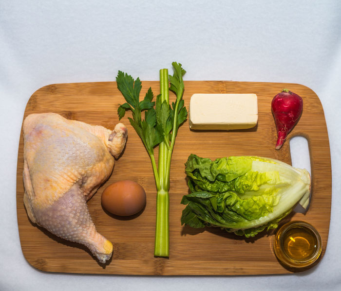 Ketogenic diet ingredients, which is a diet consisting of 75% fat, 20% of protein and 5% carbs. Chicken leg, vegetables, oil and butter Diet Ingredients Plant Weight Loss Close-up Cutting Board Cutting Boards Dieting Food Food And Drink Freshness Garlic Health Healthy Eating Healthy Lifestyle Indoors  Ingredient Ketogenic Meal Planning No People Preparation  Raw Food Vegetable White Background