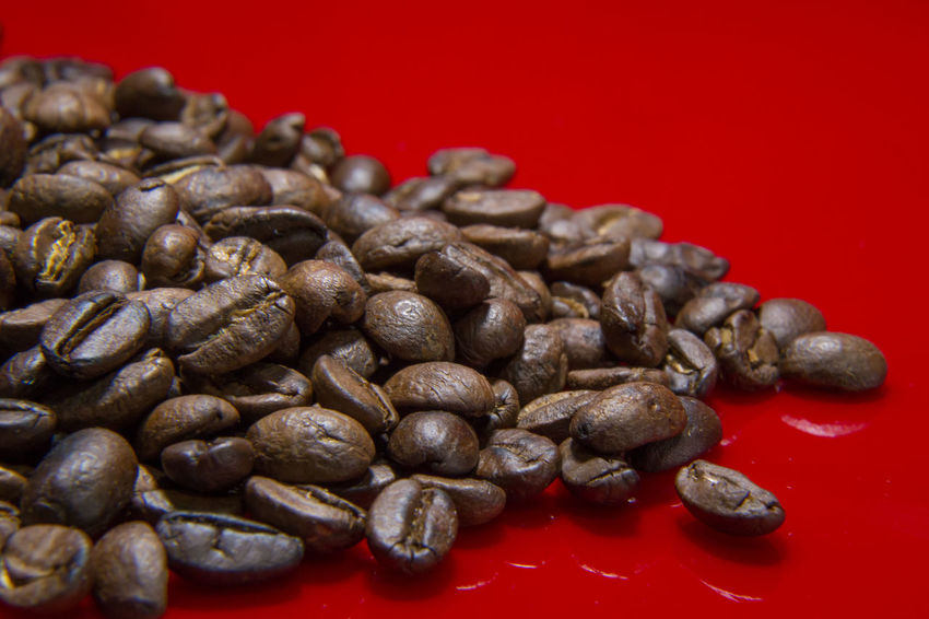 The Roasted Coffee Beans red background macro close up image for coffee background. Roasted Coffee Beans Coffee Beans Baker Coffee Beans Roasted Close-up Coffee Bean Coffee Beans Coffee Beans For Sale Coffee Beans Roaster Food Food And Drink Freshness Healthy Eating Indoors  Large Group Of Objects No People Raw Coffee Bean Red Roasted Roasted Coffee Roasted Coffee Bean