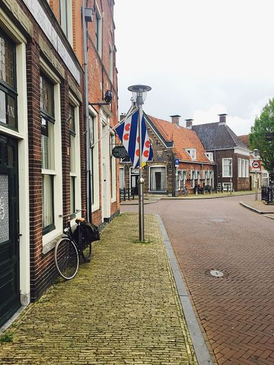 Sneek Friesland Fryslan Flag Bakery Architecture Street Outdoors Dutch Pretty Bicycle Bike No People City Beautiful Atmosphere Netherlands Scenics View Valley Vibes Good Old-fashioned Character Authentic