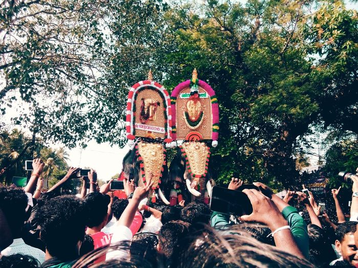 People Standing Against Decorated Elephants During Pooram Festival