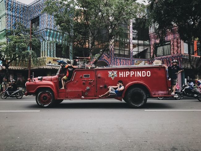Casual Firefighters Land Vehicle Mode Of Transport Transportation Architecture Red Tree Fire Engine Building Exterior Car Outdoors Day Built Structure People Chilling The Street Photographer - 2017 EyeEm Awards Colour Your Horizn This Is Masculinity