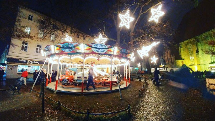 Illuminated carousel in amusement park