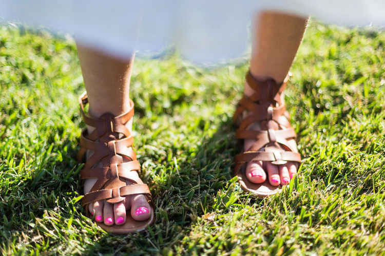 Kids feet with pink toenails Backyard Bokeh Bokeh Photography Bokehlicious Close-up Day Grass Grass Green Grass Human Body Part Human Foot Kids Feet Leather Sandals One Person Outdoors Pedicure Pink Color Pink Toenails Pokadots Real People Sandal Sandals Shallow Depth Of Field Standing Toenails