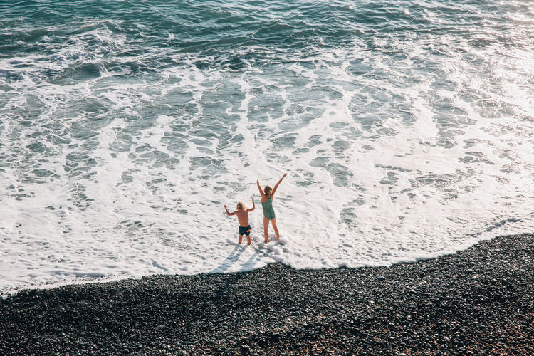 High angle view of person standing on beach