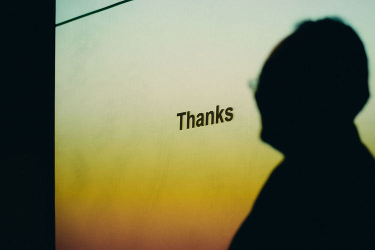 Thanks Capital Letter Close-up Communication Focus On Foreground Guidance Indoors  Information Information Sign Lifestyles Men Message Non-western Script Real People Sign Silhouette Text Thanks  Wall - Building Feature Western Script