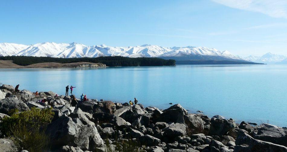 Lake pukaki against snowcapped mountain