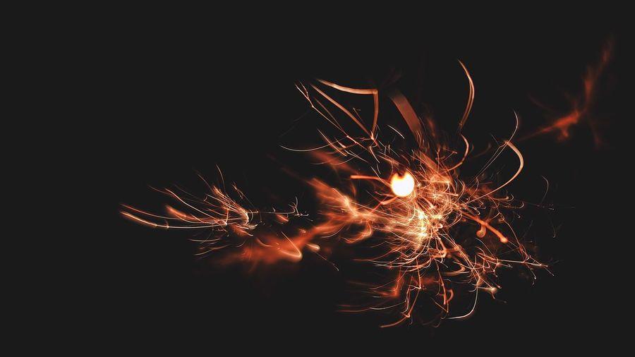 Close-up of firework display at night