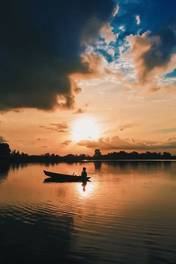 Going home Canon Eyeemphotography BerauASIK Sunset Water Sky Cloud - Sky Reflection Beauty In Nature Nautical Vessel Lake One Person Orange Color