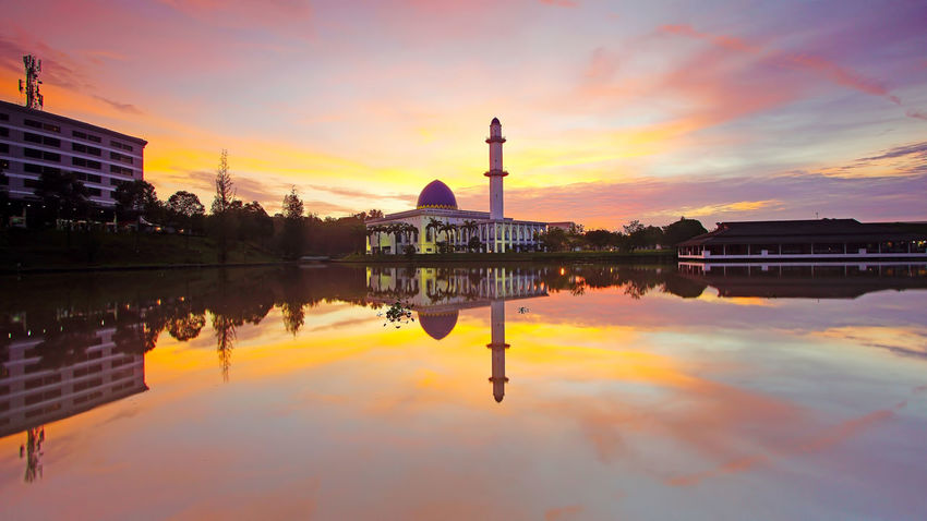 Reflection Sky Water Outdoors Malaysia Truly Asia Sunrise N Sunsets Worldwide  Sunrise N Sunsets Worldwide  Malaysia Tourism Architecture Mosque Religion Travel Travel Destinations Dome Built Structure Building Exterior Ancient Sunrise_Collection
