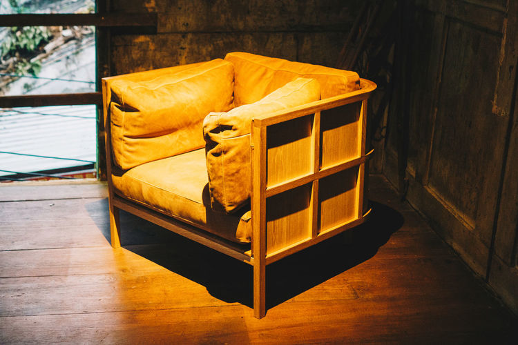 Furniture Indoors  Wood - Material No People Flooring Pillow Home Interior Orange Color Absence Domestic Room Still Life Yellow Relaxation Wood Day Seat Sofa Cushion Architecture Empty Cozy