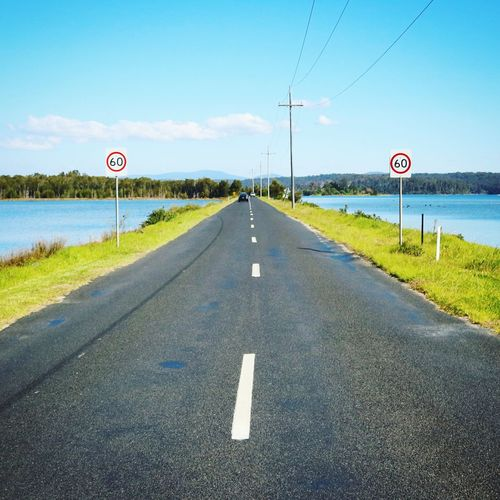 Road Sign Road The Way Forward Speed Limit Sign Arrow Symbol Communication Guidance Traffic Arrow Sign Warning Sign Number Road Marking Direction Transportation Text Asphalt Day No People Bicycle Lane Outdoors Sky