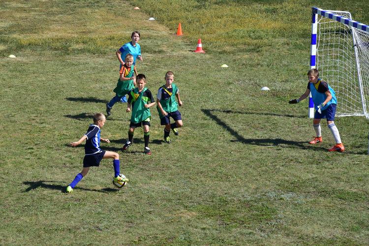 Children playing soccer on field