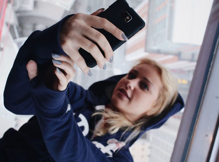 Close-up of woman taking selfie with mobile phone