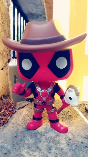 Deadpool Playing Casual Clothing Front View Person Red Outdoor Play Equipment Outdoors Upclose  In Front Of Popfunko Eyem Best Shots Imagination Creativity Cowboy Funkopopvinyl Deadpool Figure Deadpool Costume Still Life Close-up Colorful Vibrant Color Bestever Single Object Fun