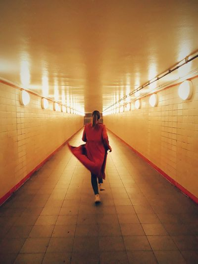 Running Berlin Urbanphotography Urban Isolation City City Full Length Women Illuminated Subway Train Walking Rear View City Life Purse Journey Subway Subway Station Underpass Tunnel Underground Tiled Wall Light At The End Of The Tunnel Underground Walkway A New Beginning EyeEmNewHere