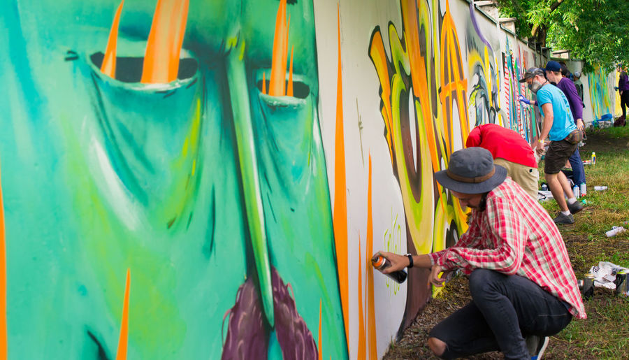 Art Art And Craft Boys Colorful Creativity Graffiti Graffiti Graffiti Art Graffiti Wall Guy Hands At Work Modern Modern Art Multi Colored Mural Mural Art Outdoor Photography Outdoors Painting People And Places Street Street Photography Togetherness Young Youth Of Today