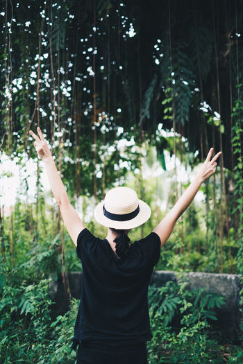 rear view of a person wearing black shirt and pants, and a cream boho hat, with arms raised upwards Unisex Men Real People One Person Hat Standing Human Arm Plant Women Arms Raised Lifestyles Leisure Activity Tree Waist Up Nature Clothing Rear View Adult Forest Casual Clothing Three Quarter Length Outdoors Freedom WoodLand Human Limb Hairstyle Bohemian Moments Of Happiness It's About The Journey My Best Photo International Women's Day 2019 Exploring Fun