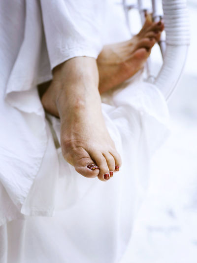 Low section of woman with painted toe nails