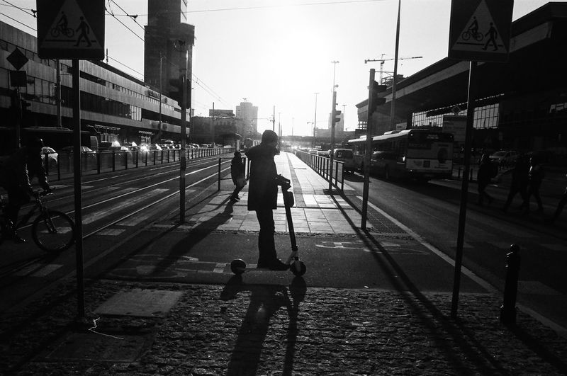 ANALOG; Rollei RPX 100 The Week on EyeEm Light And Shadow Capture The Moment Film Photography Rollei Analogue Photography Nikonphotography Street Photography Monochrome Black And White Bnw Spring Filmisnotdead Grain Rail Transportation Transportation Railroad Track Track Real People Building Exterior City Mode Of Transportation Architecture Street Public Transportation Built Structure Men Full Length Nature Lifestyles Railroad Station Sky Incidental People People Outdoors The Art Of Street Photography