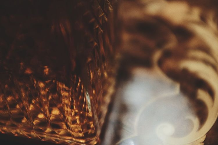 Close-up of illuminated glass in basket