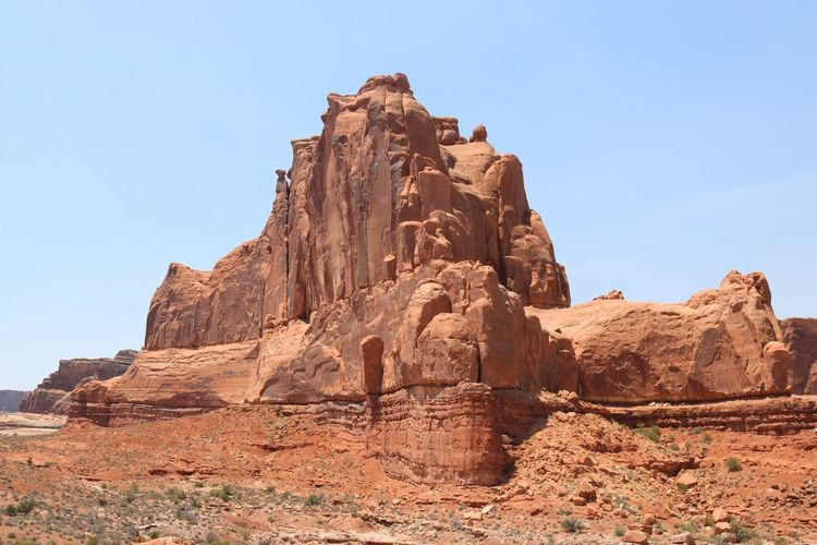 Low angle view of rock formations at arches national park against clear sky
