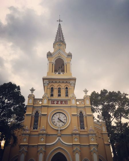 Religion Spirituality Place Of Worship Architecture Low Angle View Built Structure Tree Outdoors No People Façade Cross Bell Tower Clock Tower Building Exterior Clock Cloud - Sky Rose Window Day Sky