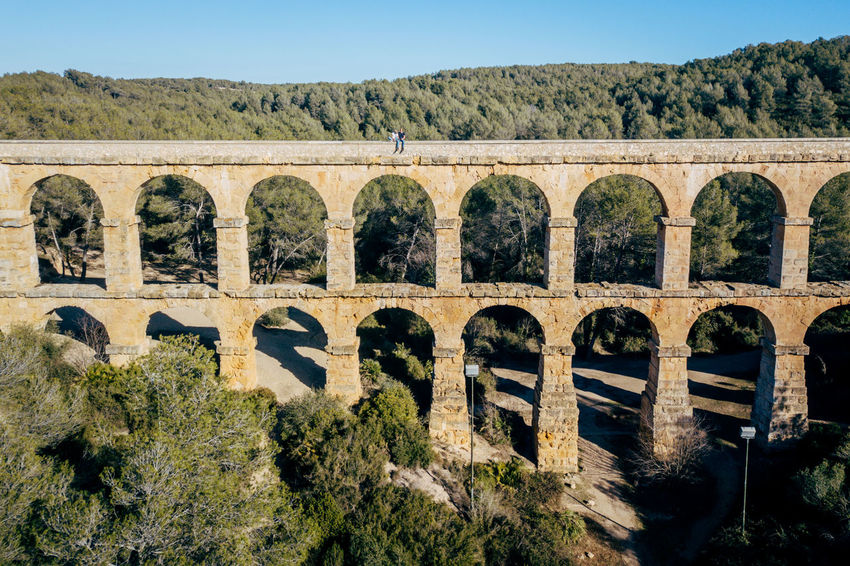 Aqueduct DJI X Eyeem Drone  The Ferreres Aqueduct Aerial Aerial View Architecture Bridge Bridge - Man Made Structure Clear Sky Day Dronephotography Landscape Mountain Nature No People Old Outdoors Sky Tree