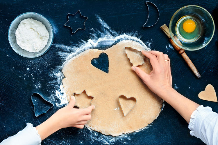 High angle view of woman and child making cookies