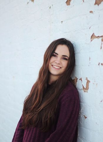 Wall - Building Feature Looking At Camera Smiling Portrait Long Hair One Person Young Adult