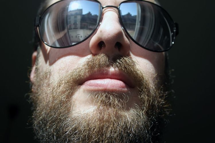 Close-Up Of Man Wearing Sunglasses During Sunny Day