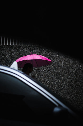 Purple Savage Car Transportation Motor Vehicle Mode Of Transportation Umbrella Road Rain Land Vehicle Protection Wet Nature Glass - Material Security Night One Person City Outdoors Pink Color Dark Rainy Season Street Photography EyeEm Best Shots EyeEm Selects The Art Of Street Photography The Street Photographer - 2019 EyeEm Awards
