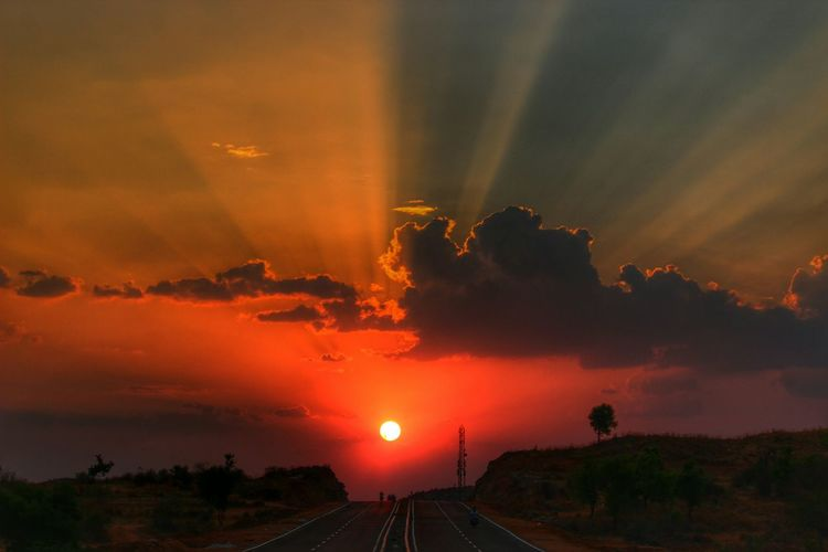 Scenic view of sunset over road
