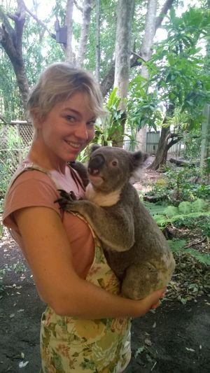 Woman carrying a koala