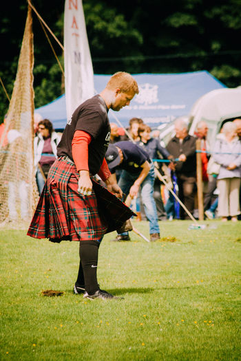 Full Length Highland Games Holding Kilt Leisure Activity Lifestyles Men Real People Standing Weight Throw