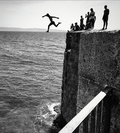 CliffJumping EyeEm Best Shots EyeEm Best Shots - Black + White Israel Travel Travel Photography Cliffjump Horizon Blackandwhite Monochrome Silhouette Sea People People Photography EyeEm Bnw