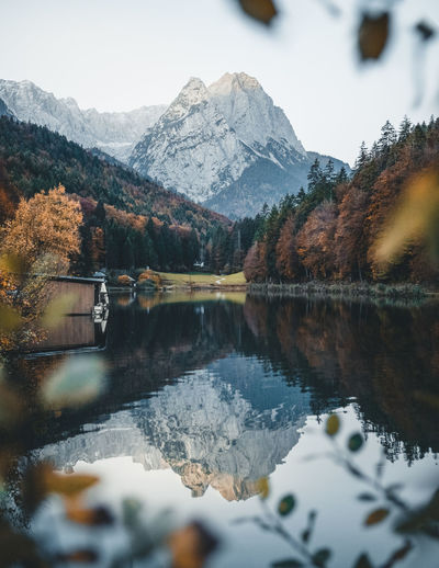 autumn leaves and perfect reflection Reflection Mountain Water Beauty In Nature Scenics - Nature Tranquility Lake Tranquil Scene Mountain Range Nature Tree Day Plant No People Outdoors Mountain Peak Autumn Frame Leaves Green Outdoor Photography Travel Destinations Travel Lake View Boat