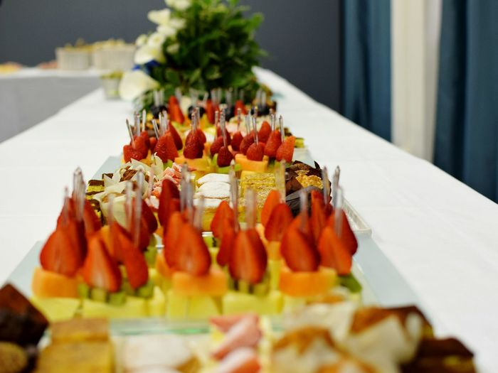 Desserts Arranged In Trays On Table