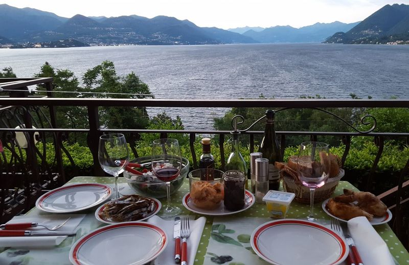 Lago Maggiore, Italy Tranquillity Balcony View Rural Scene Beauty In Nature Lakeview View Dinner With Friends Dinner Dinner Table Italy Italian Food Plate Friendship Food Virgin Olive Oil Relaxing Table Tablecloth Wineglass Drink Scenics Nature Mountain Italianlandscape