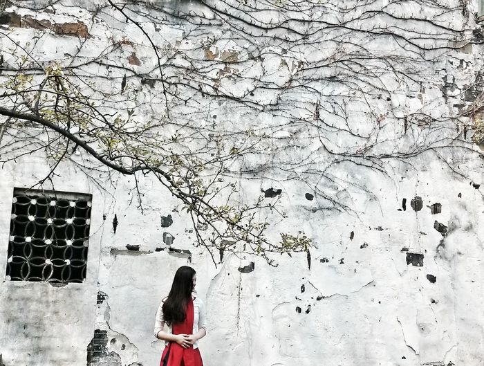 A girl in old town Colour Of Life Colour Palette Old Town Architecture Old Time Girl Red And Black White Background In The Trip Portrait Chinese Garden Smartphone Photography Architecture And Nature New Talent in Xitang, Zhejiang China