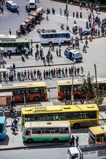 High angle view of people sitting on road against sky