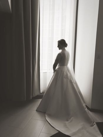 Bride Wedding Curtain Indoors  Wedding Dress One Person Young Women Standing Window Full Length Life Events Real People Anticipation Blackandwhite