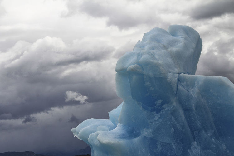 Ice Iceberg Clouds And Sky Cloud - Sky Sky Snow Cold Temperature Beauty In Nature Nature Winter No People Frozen Day Scenics - Nature Tranquility Tranquil Scene Sculpture Environment Statue White Color Outdoors Softness