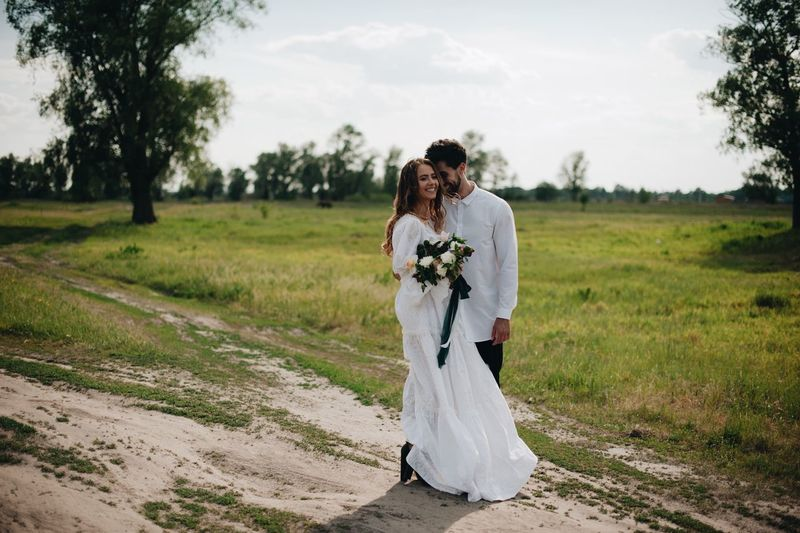 love story of young couple Adult Bride Bridegroom Couple - Relationship Females Full Length Land Life Events Love Married Men Nature Newlywed Outdoors Plant Positive Emotion Real People Togetherness Two People Wedding Women