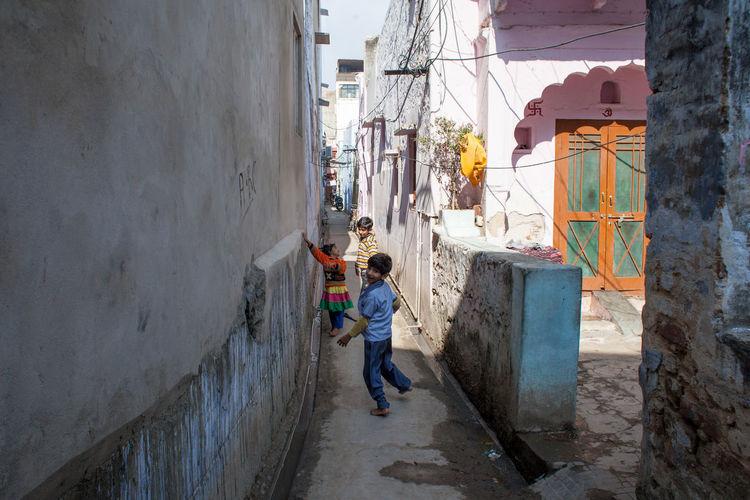 Children on footpath in city