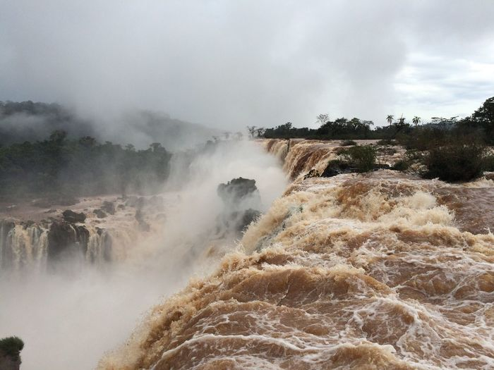 Scenic view of iguacu falls during foggy weather