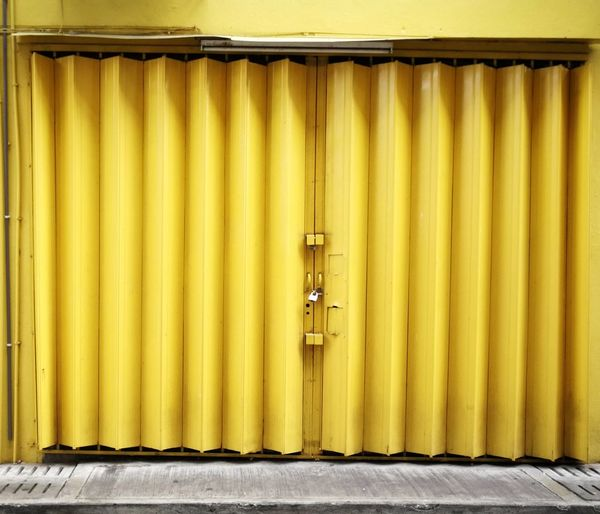 Safety door Corrugated Iron Hinge Industry Cargo Container Commercial Dock Backgrounds Yellow Steel Freight Transportation Pattern Closed Loading Dock Doorknob Closed Door Door Door Handle Keyhole