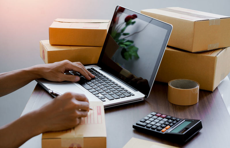 Online seller write customer address for delivery to customer.