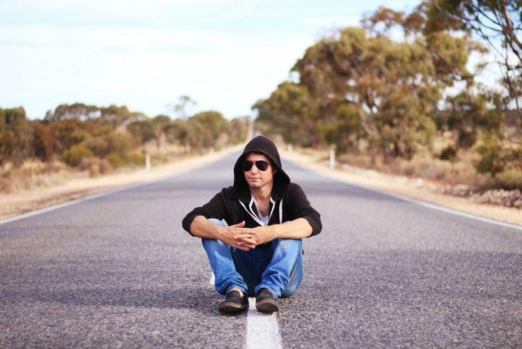 Country Australia Man Male Long Road EyeEm Selects Beauty Portrait Sitting Human Hand Beautiful People Rural Scene Road Autumn Country Road Empty Road Asphalt Roadways White Line