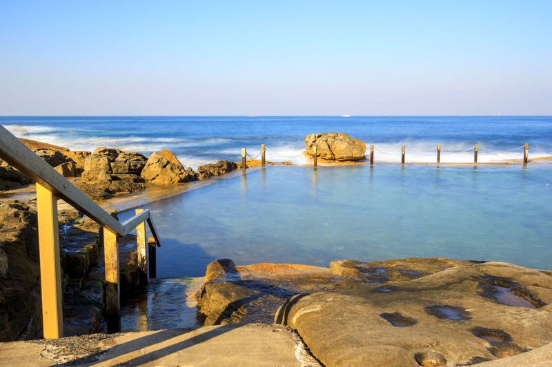 Slow down capture of the Mahon Rock Pool, with smooth waves and water. The railing leading in the pool is visible. Swimming Beach Beauty In Nature Clear Sky Day Horizon Over Water Mahon Pool Nature No People Outdoors Pool Rock - Object Rock Pools Scenics Sea Sky Swimming Pool Tranquil Scene Tranquility Travel Destinations Water