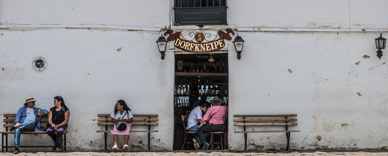 Architecture Benches Building Exterior Built Structure Colonial Architecture Day Dorfkneipe Drinking Façade Gossip Lifestyles Nostalgia Old School Old Town Outdoors Pub Real People Simple White Wall
